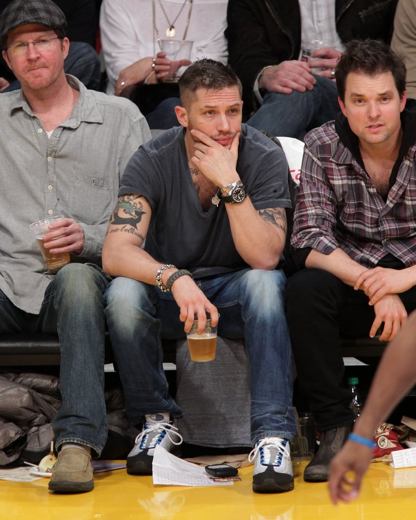 Tom Hardy sat courtside at the Lakers game on Friday night, following in the footsteps of his This Means War costar Reese Witherspoon, who attended a game with her fiance Jim Toth last week. The busy Brit has recently been filming Tinker Tailor Soldier Spy in Istanbul and London, and is set to star in The Wettest County In the World alongside Shia Labeouf. Shooting on that is expected to start this month in Georgia, but before he gets back to hard work he spent downtime watching the basketball with friends including writer Brett C. Leonard. Also spotted in the crowd was his fellow Brit Sacha Baron Cohen.