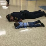 The Story Behind the Viral Photo of a Police Officer Lying on the Floor With a Little Boy