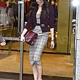 Victoria Beckham carried a large clutch in her hand.