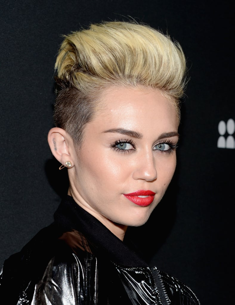Styling her undercut style into a pompadour, Miley Cyrus's bold brows and orange-red lipstick were on full display.