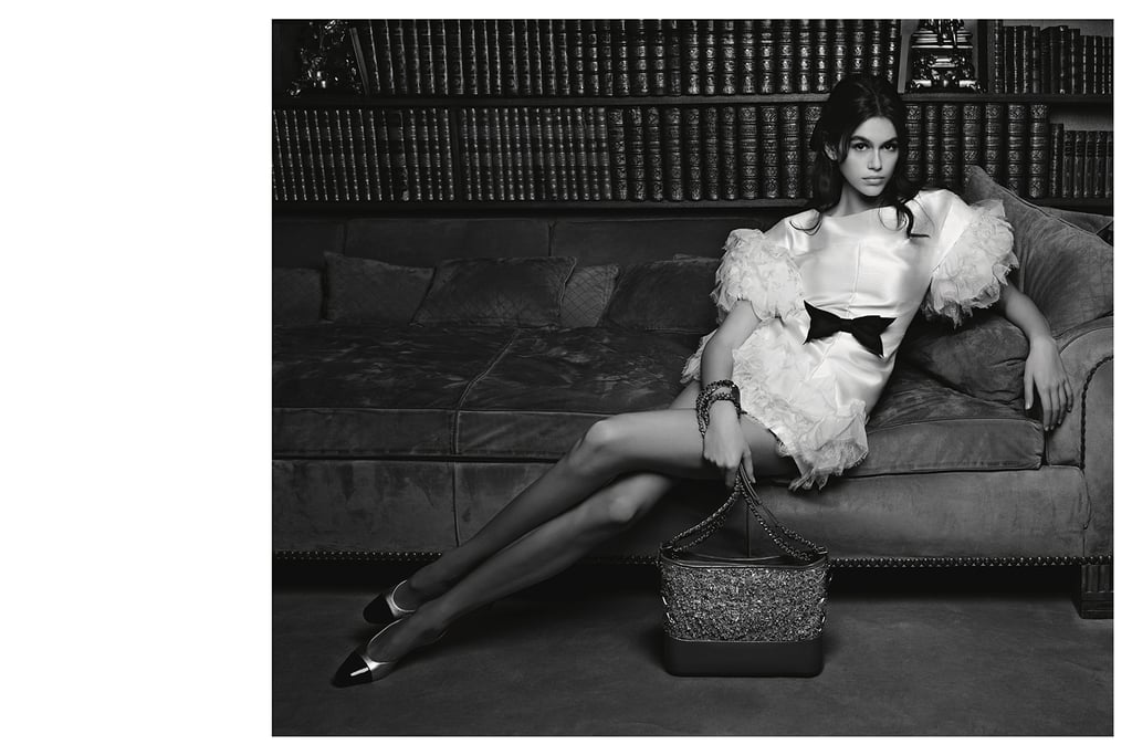 "Update: Chanel has been catching some heat for its latest campaign starring Kaia Gerber. People voiced their opinions on the brand's Facebook and Instagram, debating the luxury brand's decision to use the 16-year-old model. Some feel that she is too young, while others claim that she's barely dressed in the photos, even though she is pictured in a simple white dress.  Original Post: For some people, chilling on the couch involves a bowl of chips, comfortable sweatpants, and probably a messy bun. For Kaia Gerber though, who posed on Coco Chanel's suede couch for the brand's new Spring 2018 handbag campaign, ""lounging"" has never been so fabulous. This was Kaia's first-ever Chanel campaign, and Karl Lagerfeld shot her inside the late French designer's glamorous Parisian apartment.  In the photos, the model stretches her legs across the couch and, even at such a young age, embodies the true timelessness of the brand. (In case you forgot, this 16-year-old model has owned the Fashion Week runways and made a 25-year-old adult like myself jealous of every outfit she rocks.) As for Chanel's iconic bags in the campaign, they received an edgy upgrade with colorful designs like embroidered tweed and PVC.  Read on to see the images from Kaia's first Chanel campaign. Then check out all the reasons she was born to follow in mom Cindy Crawford's footsteps. — Additional reporting by Nikita Ramsinghani      Related:                                                                                                           Kaia Gerber Is Adding Designer to Her Résumé With a New Karl Lagerfeld Collection"