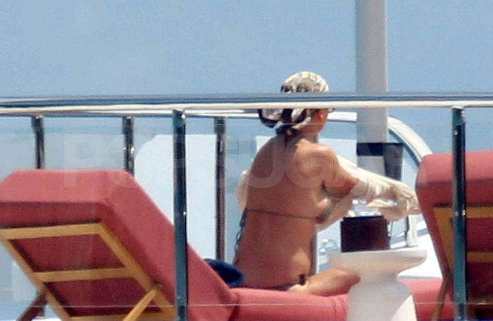 Catherine Zeta-Jones wears a bikini on a yacht in Italy.