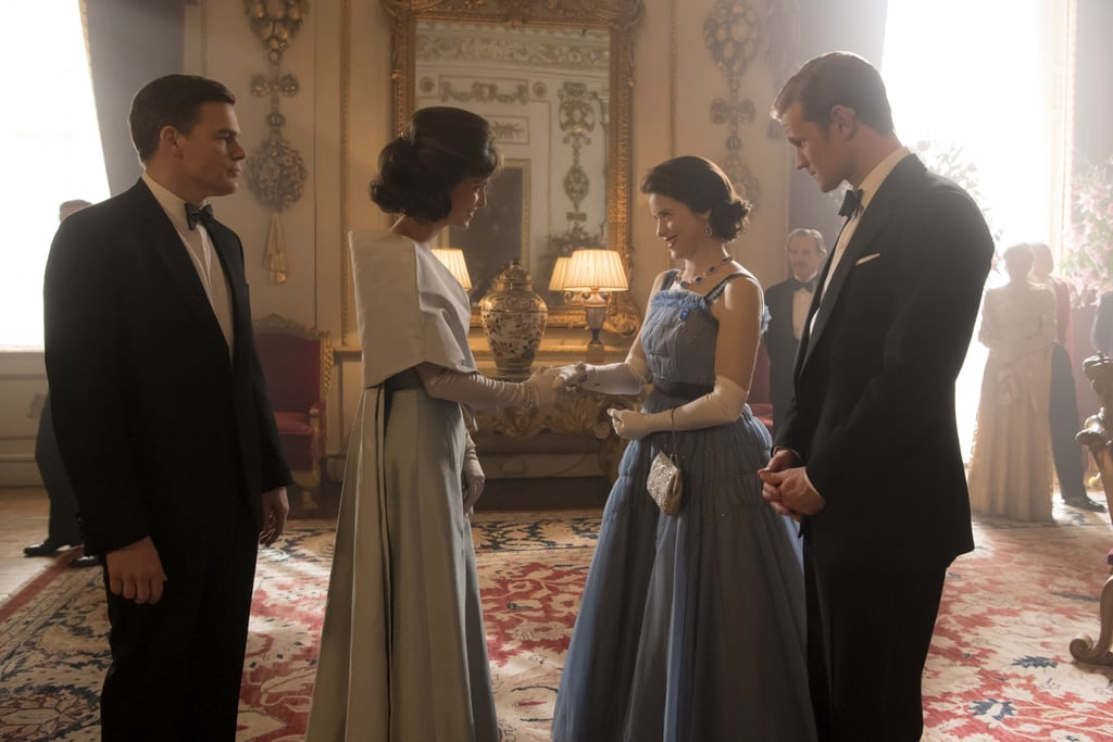 "The Crown's production value is so mind bogglingly massive (like, $130 million massive) it hurts my brain to even type about it, but I'm going to push through the pain so we can discuss season two's eighth episode, ""Dear Mrs. Kennedy."" As you can gather from the title, the episode pulls out all the stops for a lavish recreation of a dinner at Buckingham Palace for President John F. Kennedy and First Lady Jackie Kennedy in June of 1961. To be honest, the meeting between the two power couples — JFK and Jackie (Michael C. Hall and Jodi Balfour), and Queen Elizabeth II and Prince Philip (Claire Foy and Matt Smith) — starts off as a small disaster. The Kennedys greet the royals incorrectly, neglecting to curtsy or address them with the proper titles. Fortunately Elizabeth and Jackie are able to find common ground later on in the evening, when they bond during a private chat away from the other guests. So, how accurately does the Netflix hit portray their meeting?  From subtle differences in their gowns and hairstyles to the look of the actual palace's decor, keep reading to see how the show and the real-life interaction compare.      Related:                                                                                                           Everyone From Netflix's The Crown — Next to the Real Royals"