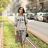We could live in this kind of style combo — a cheeky sweatshirt over a sweet collared dress? We're sold. Source: Greg Kessler