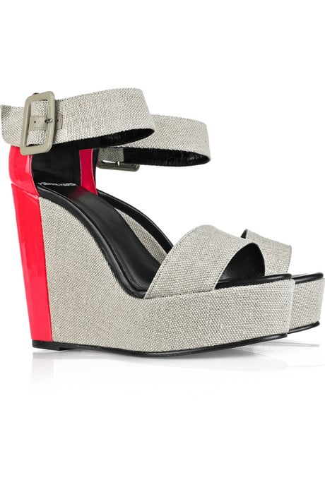 We love the light linen texture and patent red pop.  Pierre Hardy Colorblock Wedges ($378, originally $630)
