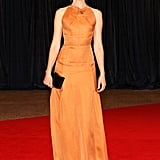 Elizabeth Banks brought vibrant color to the carpet in a tangerine-colored halter-style gown and Irene Neuwirth jewels.