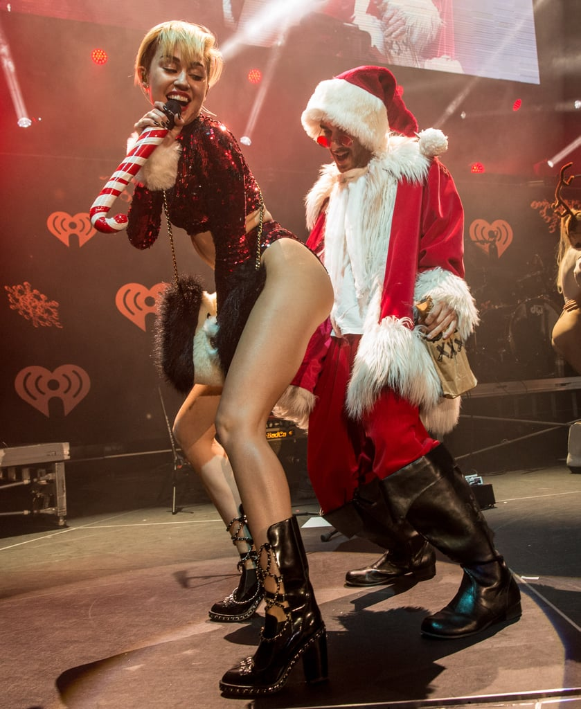 Miley Cyrus may have made Mrs. Claus jealous when she got up close and personal with Santa at KIIS FM's Jingle Ball in LA.