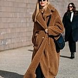 Look cool while staying warm like Joanna HIllman in a teddy bear coat.