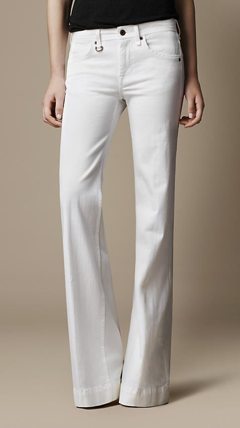 I'd happily live in white jeans, year-round, but they feel most appropriate for the Summer months. My latest styling trick is doing them in a super flare fit like this Burberry pair ($250). It's like an instant skinny mirror that everyone can see.  — LM