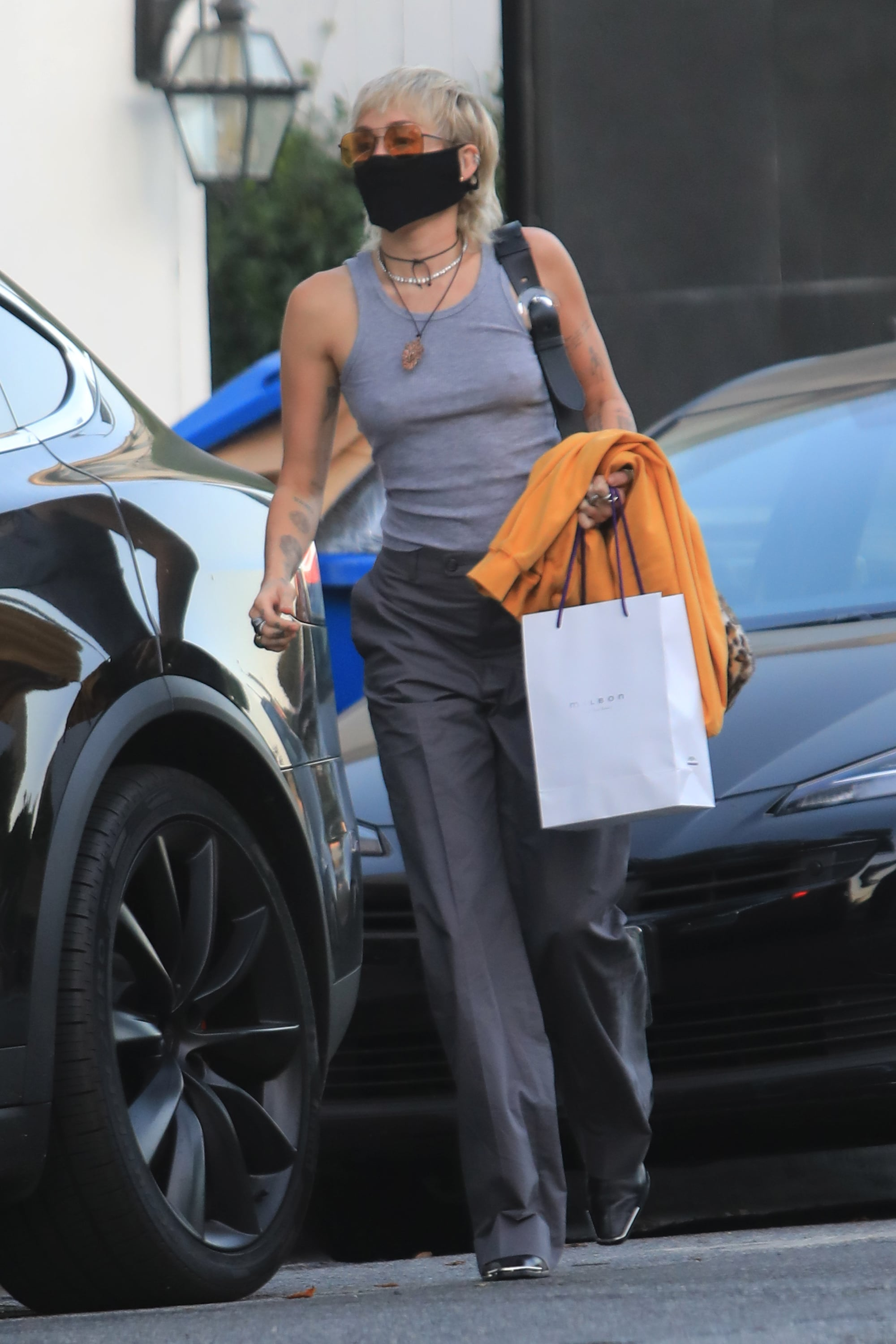 Miley Cyrus Wears a Gray Tank Top and Trousers | POPSUGAR Fashion