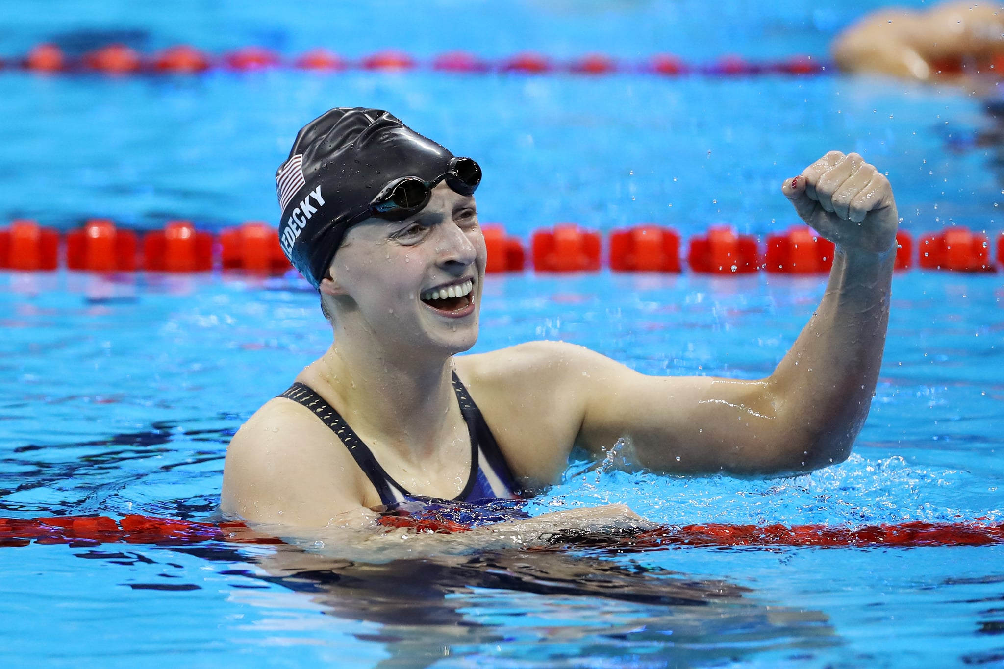 RIO DE JANEIRO, BRAZIL - AUGUST 09:  Katie Ledecky of the United States celebrates winning gold in the Women's 200m Freestyle Final on Day 4 of the Rio 2016 Olympic Games at the Olympic Aquatics Stadium on August 9, 2016 in Rio de Janeiro, Brazil.  (Photo by Al Bello/Getty Images)