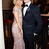 Sienna Miller cosied up to Tom Sturridge at the London Evening Standard Theatre Awards.