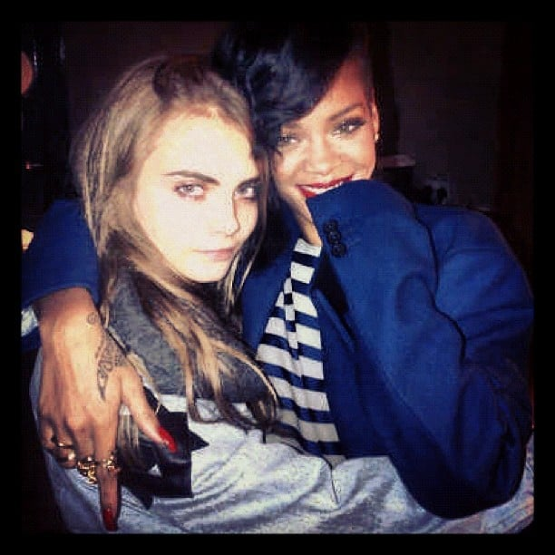 Cara Delevingne and Rihanna cuddled up on the singer's 777 tour. Source: Instagram user caradelevingne