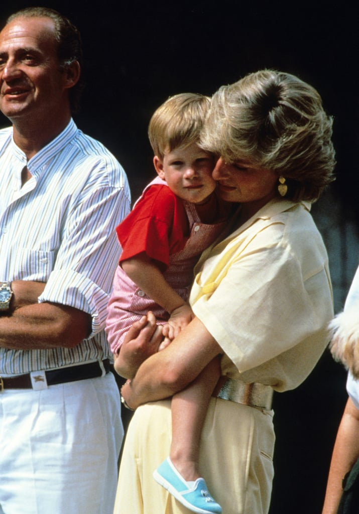 Princess Diana cuddled a young Harry in her arms during the family's 1987 visit to Spain.