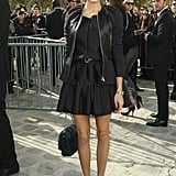 Olivia closed out the week in Paris at Dior, opting for girlie flared Christian Dior dress, then topping it with a leather-paneled jacket from the label as well. Per usual, it was her mix of accessories that sealed the deal — a furry Dior chain-strap bag and perfectly ladylike Giuseppe Zanotti pumps.