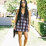 Zoe Kravitz played up the colors of her lightweight plaid dress with two-tone Marc by Marc Jacobs sunglasses. She balanced her look with black edgy boots.