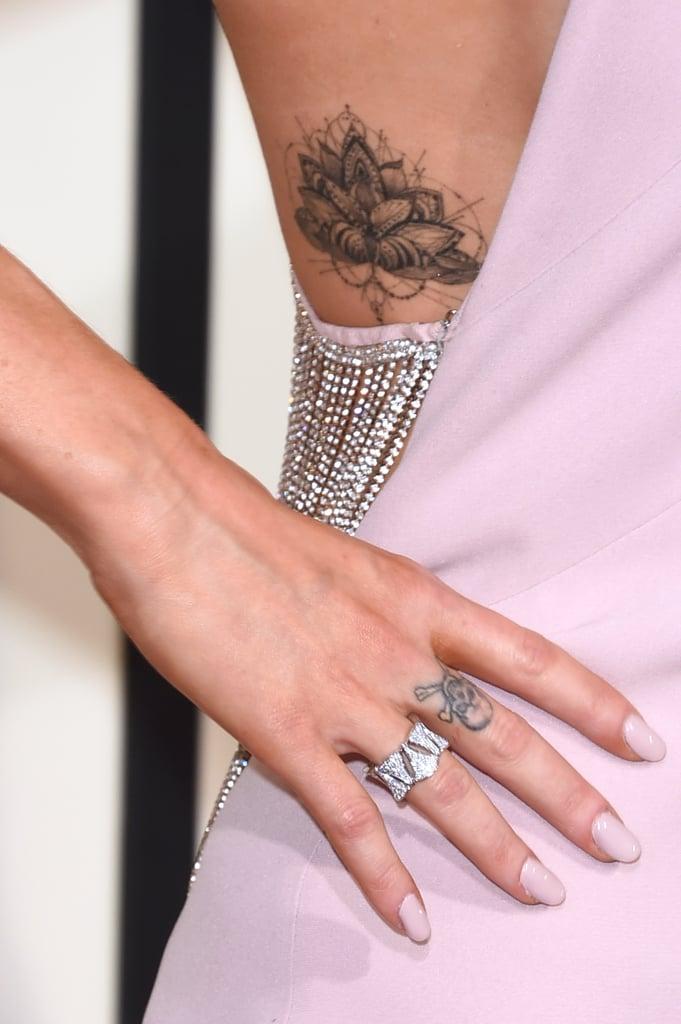 Wearing a Bvlgari ring.