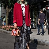 An easy way to try the red and pink combination? Start with a pink or red shoe and build your outfit from there. This street style star threw a bright blazer over her sequined skirt and graphic top and really brought the look together with her pastel pink pumps.