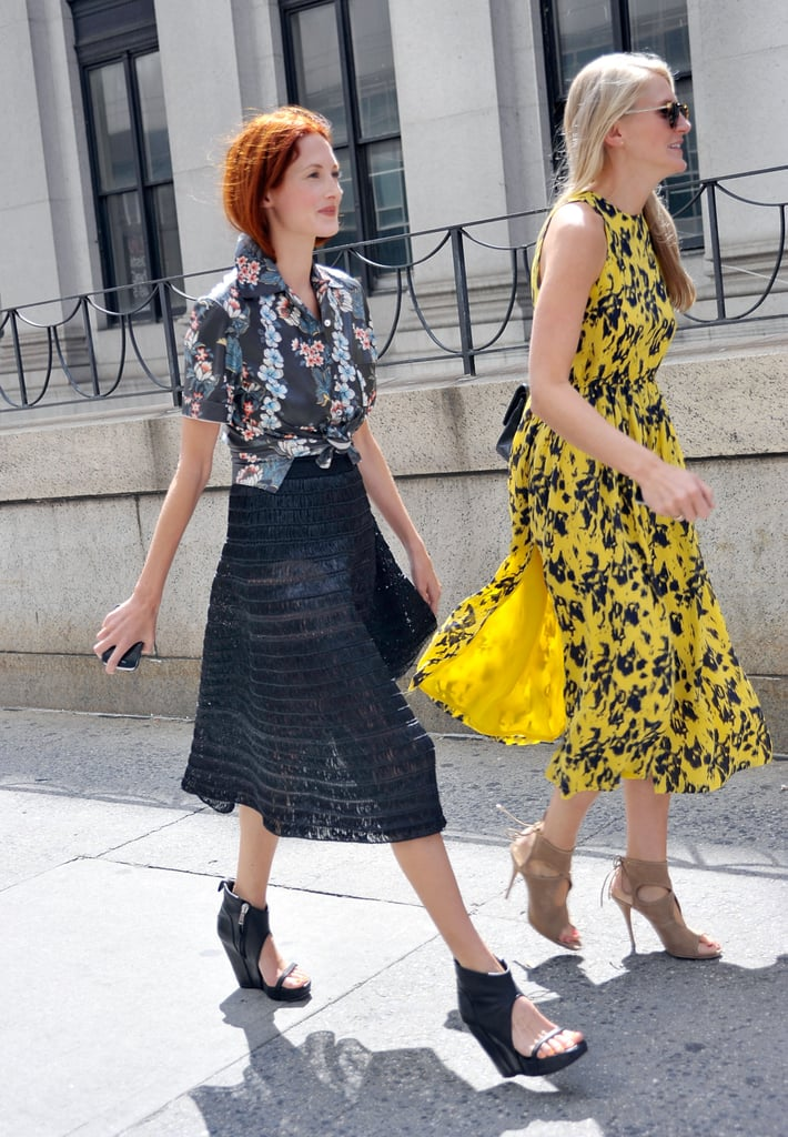 Taylor Tomasi Hill (left) proved her style versatility once again, slipping into a tropical-print button-down, textured midi skirt, and cut-out wedges. Her equally stylish companion made the rounds in a printed dress and lace-up heels.