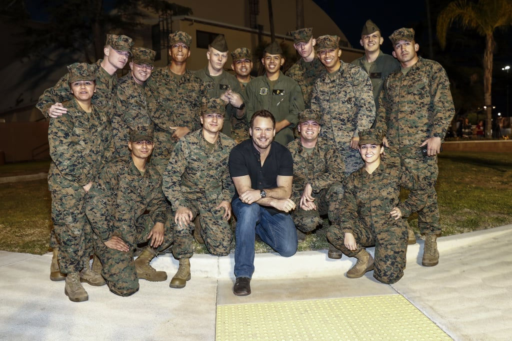 When he's not trying to crop Jennifer Lawrence out of photos or jet-setting around Europe to promote his latest blockbuster, Chris Pratt is busy making time for his many fans. In addition to regularly visiting children's hospitals (sometimes even dressed as his Guardians of the Galaxy character), the down-to-earth dad has always made his love for the servicemen and servicewomen who protect our country known. On Monday, he made a fun visit to a Marine Corps Air Station in San Diego, where he had a blast hanging with both the soldiers and some adorable kids who were on the base to meet him. While there, Chris took a tour around an air hangar and struck a few poses with the jets, including a glorious flex of his insanely big bicep. Later on he gave everyone a private screening of his new movie, Passengers, which we're willing to bet was only slightly more entertaining than his hilarious bickering with J Law.      Related:                                                                                                           Chris Evans Meets Troops on USO Tour, Proves He's Captain America in Real Life, Too