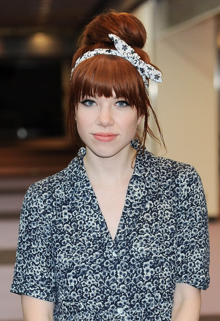 Spotted at the Narita National Airport in Tokyo, Carly Rae Jepsen opted for a voluminous topknot secured with a scarf headband.