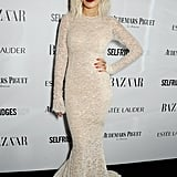 Rita Ora wore a chic yet dramatic Ermanno Scervino dress at the Harpers Bazaar Women of the Year Awards in 2013. We love the vampy lipstick!