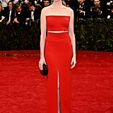 The actress flaunted a hint of skin at the 2014 Met Gala in a fiery look from Calvin Klein Collection.