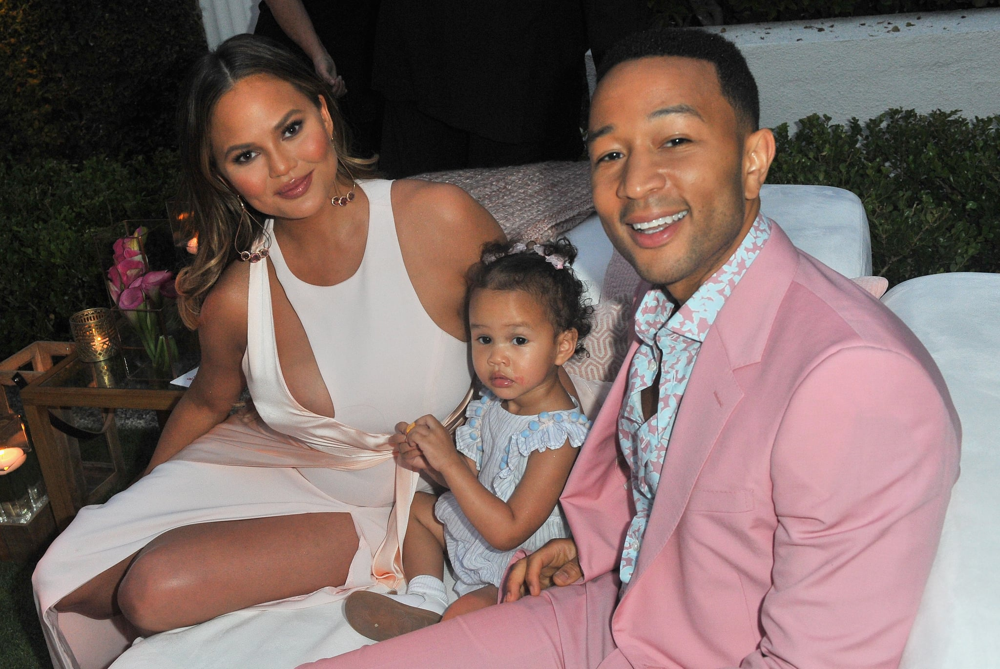 BEVERLY HILLS, CA - JUNE 21:  (L-R) Chrissy Teigen, Luna Simone Stephens and John Legend attend John Legend's launch of his new rose wine brand, LVE, during an intimate Airbnb Concert on June 21, 2018 in Beverly Hills, California.  (Photo by Jerod Harris/Getty Images for Airbnb)