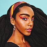 For an extra edge, Cipriana's makeup look is accented by Dior J'adior Asymmetric Earrings.