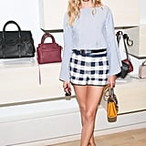 For Rebecca Minkoff (during one of NYFW's hottest days), the style star suited up in mixed prints, adding interest to checked shorts with a striped top.