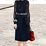 Hack: Create the illusion of a jacket by layering a sleeveless trench over mesh sleeves and wrapping a leather belt around your waist.