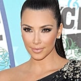 In 2010, she attended the Teen Choice Awards with a glossy, pale nude pout that directed all the attention to Kim's lush lashes.