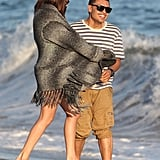 Selena Gomez played around with a male friend on the beach in Malibu.