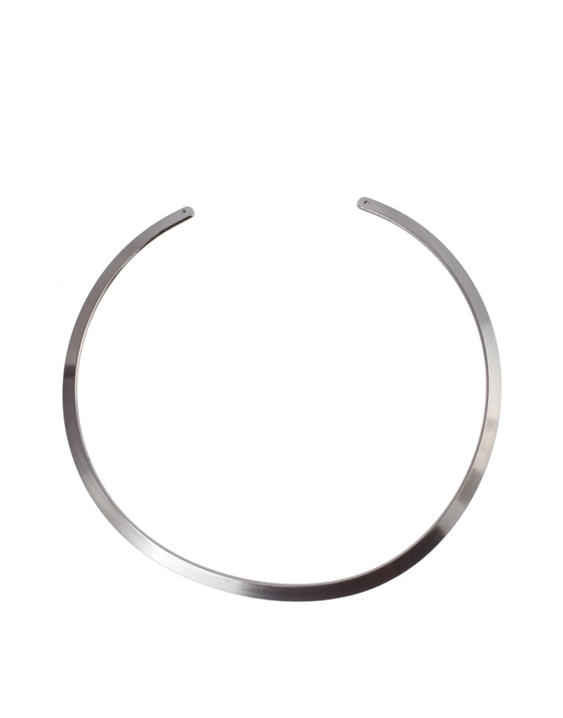 For a sleek take on the collar trend, try a silver choker silhouette.  Just Acces Wild Choker ($35)