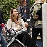 Jessica Alba feeds Haven Warren at a park in NYC.