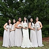 These bridesmaids wore a couple different styles of gray-beige dresses.