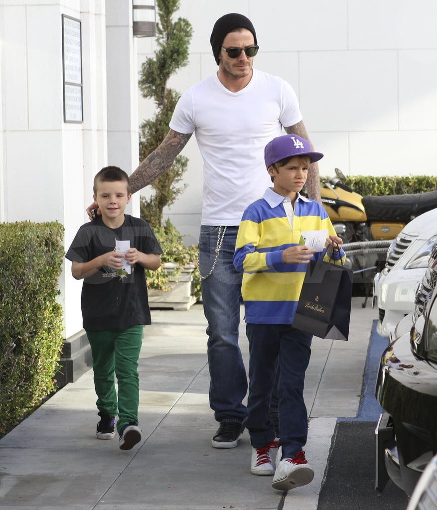 David Beckham took his sons Cruz and Romeo out to shop.