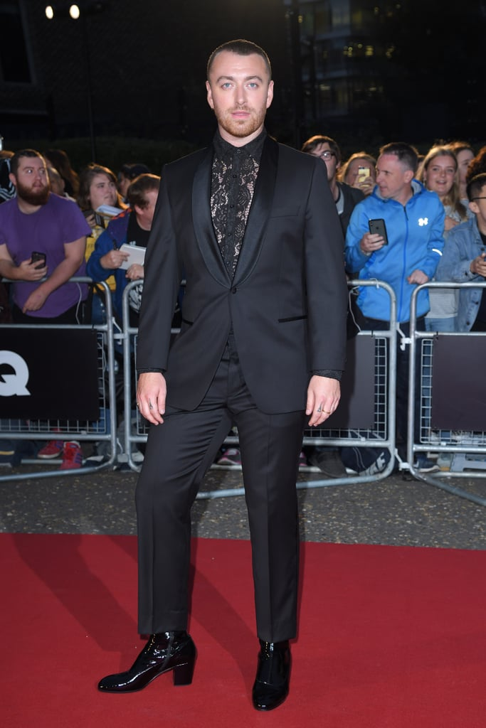 "Tuesday night was a pretty big one for Sam Smith. The ""How Do You Sleep?"" singer stepped out at the GQ Men of the Year Awards in London and walked the red carpet in a pair of patent leather Gucci heeled boots that pretty much spoke for themselves. But Sam's moment that night wasn't just special because of how great he looked — it also marked the first time he'd ever worn heels on a red carpet, something he acknowledged with a sweet Instagram photo the morning after the event. ""Tonight I wore heels for the first time to an award show,"" he captioned a photo of the shoes. ""I've just got home from a gorgeous evening and as I was walking to my front door I stopped and listened to my heels clonking against the floor. And I just thought 'FUCK YES'!! There was a time where I thought I'd never ever ever be able to be myself like this in front of the industry or anyone. It feels so good and I just wanted to share that with you all, and share a picture of my GORJ Gucci heels. They'll always be my virgin heels."" The 27-year-old paired his ""virgin heels"" with an all-black suit that he wore over a lacy blouse. Read ahead to see more photos of his outfit from all angles.      Related:                                                                                                           ""The Minute a Man Puts on a Dress, It's Disgusting"" — and Billy Porter Doesn't Have Time For That"