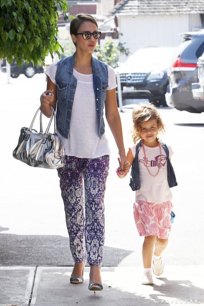Jessica Alba held her daughter Honor's hand during a girls-only outing in LA yesterday. The duo went shopping and dined at A Votre Sante, where Honor showed off her stylish side. She took cues from Jessica, wearing bright, printed bottoms; a denim jacket; and a small purse. Jessica spent the afternoon with Honor during a break from her busy schedule with The Honest Company. We visited Jessica at the brand's offices this week and got a sneak peek at a few new products they have in the works. It looks as though business and family are keeping Jessica on the West Coast during Paris Fashion Week, but she's just one of the many famous faces who have been part of the front-row fun in years past.