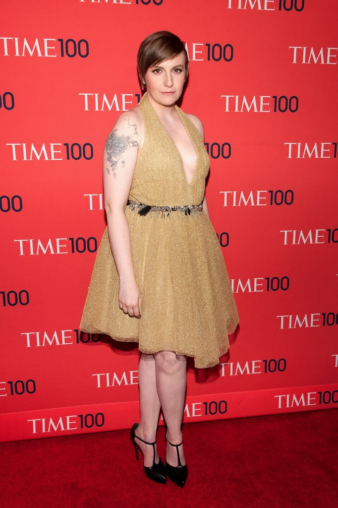 Lena Dunham stepped out at the Time 100 Gala in a gold shimmering number from Saint Laurent's Fall '13 collection. The dress — complete with plunging neckline and a silver spiked waistline — supplied a serious cocktail party vibe, and she finished the look with T-strap pumps, also from Saint Laurent, and a pair of Forevermark diamond stud earrings.