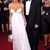 Melania wore a low-cut white dress with diamond jewelry and a feathered purse to the 2004 Emmy Awards.