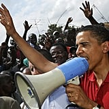 Rallying a crowd at Kenya's largest slum while visiting the country in 2006