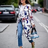 With a Printed Trench Coat, Colorful Sandals, and a Perspex Bag