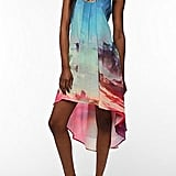 The beach landscape on this breezy asymmetrical dress has us yearning for a tropical vacation.  Sparkle & Fade Silky Photo Print Dress ($54)
