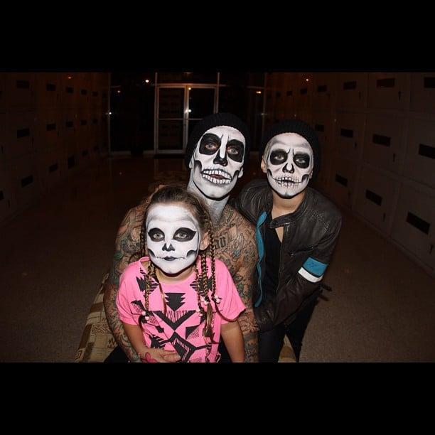 Travis Barker dressed as a skeleton with his kids. Source: Instagram user travisbarker