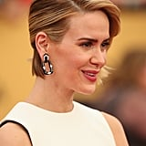 Sarah Paulson's ovular David Webb earrings were the focal point of her black and white look.