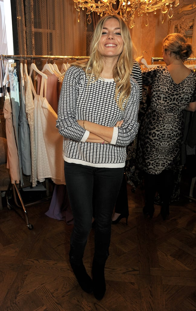 Sienna Miller paired a black-and-white checkered sweater with black jeans and boots at an event in London.