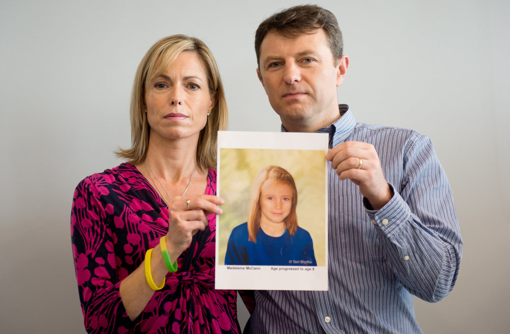 Parents of missing girl Madeleine McCann, Kate (L) and Gerry McCann (R) pose with an artist's impression of how their daughter might look now at the age of nine ahead of a press conference in central London on May 2, 2012 five years after Madeleine's disappearance while on a family holiday in Portugal.  Aged three at the time, the artist's impression depicts how Madeleine may now look, based on family photos of her, along with childhood images of her parents.  AFP PHOTO / LEON NEAL        (Photo credit should read LEON NEAL/AFP/GettyImages)