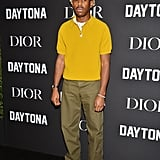 During an event for Dior and Pusha T, Tyler wore a chic mustard-colored zip-up shirt with trousers and a beige bucket hat. Chic!