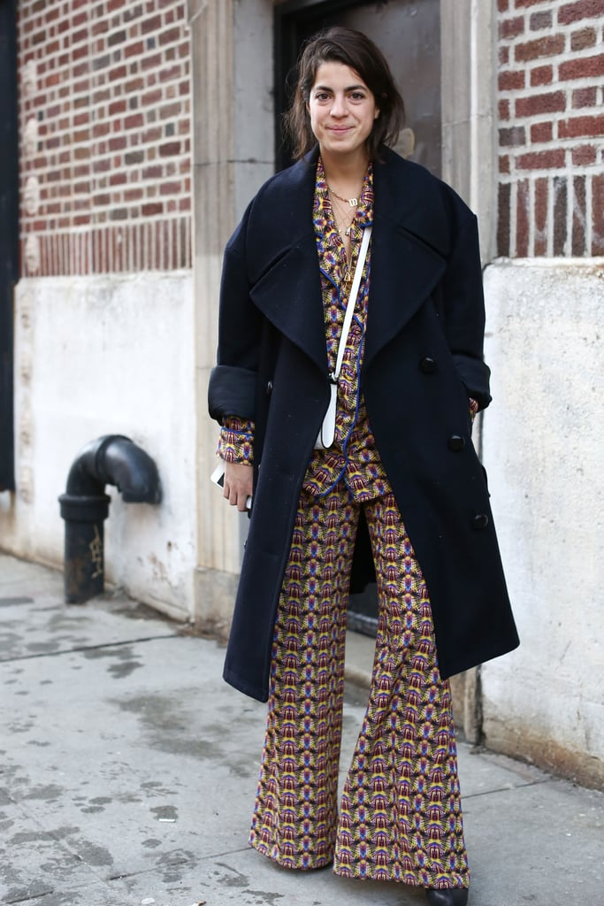 Leandra Medine looked as if she rolled right out of bed in a pair of printed PJs — and headed straight to the tents with a smart wool coat layered on top.